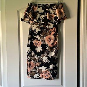 Bodycon strapless flower dress. Bust has ruffles